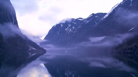 Fog-and-clouds-hang-in-the-fjords-of-Norway