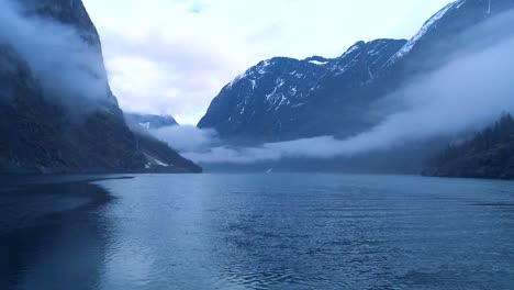 Incredible-clouds-and-fog-hang-over-a-fjord-in-Norway-in-timelapse