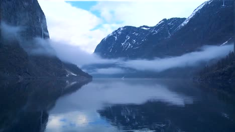 Incredible-clouds-and-fog-hang-over-a-fjord-in-Norway-in-timelapse-1