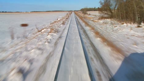 POV-from-the-front-of-a-train-passing-through-a-snowy-landscape-1