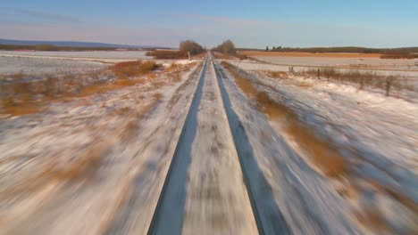 POV-from-the-front-of-a-train-passing-through-a-snowy-landscape-3