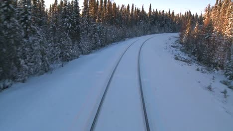 POV-from-the-front-of-a-train-passing-through-a-snowy-landscape-4