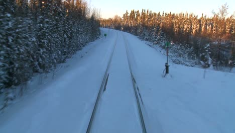 POV-from-the-front-of-a-train-passing-through-a-snowy-landscape-5
