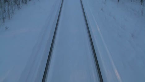 POV-from-the-front-of-a-train-passing-through-a-snowy-landscape-7