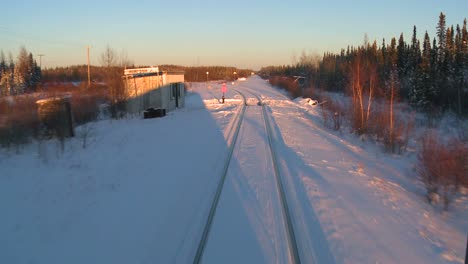 POV-from-the-front-of-a-train-passing-through-a-snowy-landscape-8