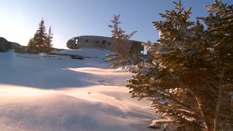 A-crashed-plane-sits-on-a-frozen-snowy-mountainside-in-the-Arctic