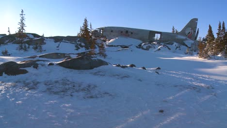 A-crashed-plane-sits-on-a-frozen-snowy-mountainside-in-the-Arctic-1