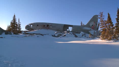 A-crashed-plane-sits-on-a-frozen-snowy-mountainside-in-the-Arctic-2