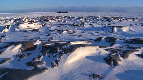 A-distant-ship-sits-trapped-in-the-ice-of-frozen-Hudson-Bay-Churchill-Manitoba-Canada