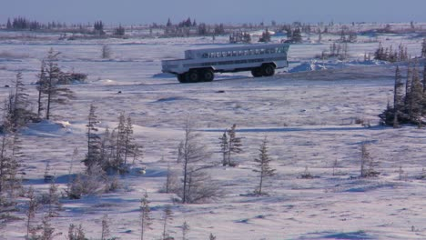 An-arctic-crawler-tundra-buggy-moves-across-the-frozen-expanse-of-Hudson-bay-Canada-2