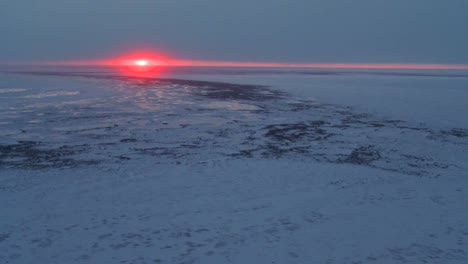 An-aerial-over-the-frozen-arctic-region-of-Hudson-bay-Canada-at-sunset-or-sunrise