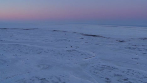 An-aerial-over-the-frozen-arctic-region-of-Hudson-bay-Canada-at-sunset-or-sunrise-1