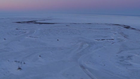 An-aerial-over-the-frozen-arctic-region-of-Hudson-bay-Canada-at-sunset-or-sunrise-2