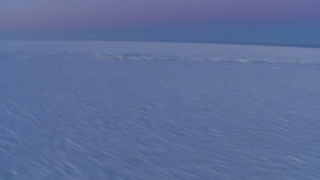 An-aerial-over-the-frozen-arctic-region-of-Hudson-bay-Canada-at-sunset-or-sunrise-3