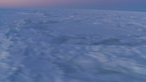 An-aerial-over-the-frozen-arctic-region-of-Hudson-bay-Canada-at-sunset-or-sunrise-4
