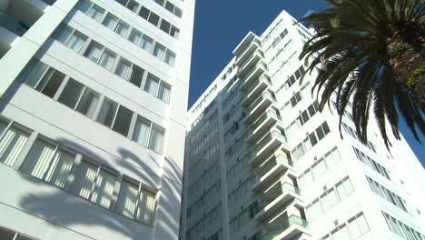 Low-angle-pan-of-a-high-rise-apartment-building-in-California-or-Miami-Beach
