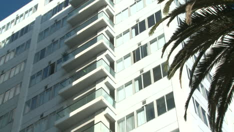 Slow-zoom-into-a-high-rise-apartment-building-in-California-or-Miami-Beach