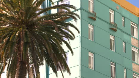 Low-angle-shot-of-a-high-rise-apartment-building-in-California-or-Miami-Beach