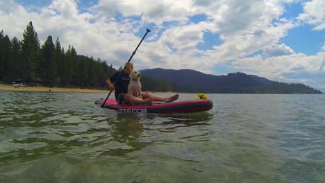 A-man-and-a-dog-paddleboard-in-Lake-Tahoe-1