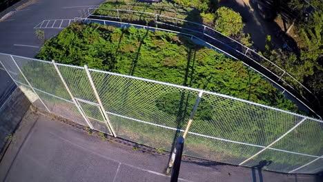 A-birds-eye-aerial-over-a-basketball-player-shooting-a-layup-on-an-outdoor-court-2