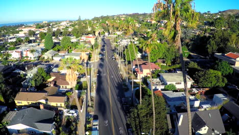 Beautiful-aerial-shot-over-a-palm-tree-lined-street-in-Southern-California