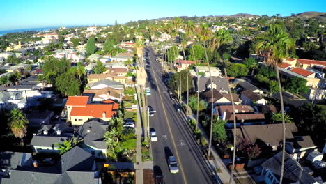 Beautiful-aerial-shot-over-a-palm-tree-lined-street-in-Southern-California-1