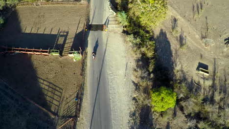 A-beautiful-aerial-shot-over-a-man-riding-his-Harley-motorcycle-on-the-open-road-3