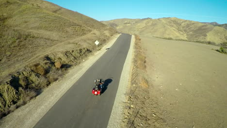 A-beautiful-aerial-shot-over-a-man-riding-his-Harley-motorcycle-on-the-open-road-4