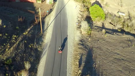 A-beautiful-aerial-shot-over-a-man-riding-his-Harley-motorcycle-on-the-open-road-6