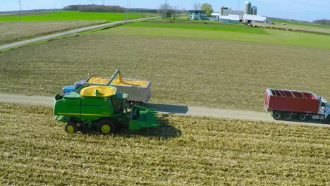 Excellent-aerial-over-a-rural-American-farm-with-corn-combine-harvester-at-work
