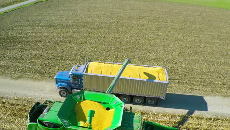 Excellent-aerial-over-a-rural-American-farm-with-corn-combine-harvester-at-work-1