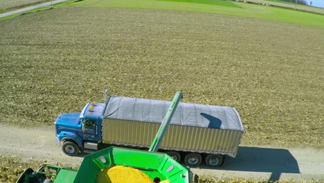 Excellent-aerial-over-a-rural-American-farm-with-corn-combine-harvester-at-work-2