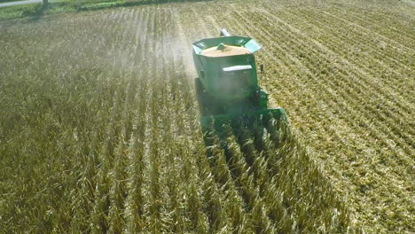 Excellent-aerial-over-a-rural-American-farm-with-corn-combine-harvester-at-work-3