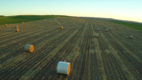 An-aerial-over-bales-of-hay-in-a-farm-field-in-the-Midwest
