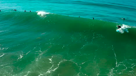 Aerial-over-surfers-riding-waves-on-a-Southern-California-beach