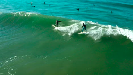Aerials-over-surfers-riding-waves-on-a-Southern-California-beach-1