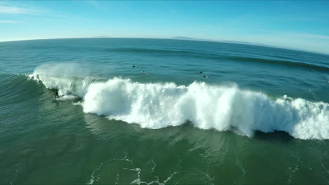 Aerial-over-surfers-riding-waves-on-a-Southern-California-beach-2