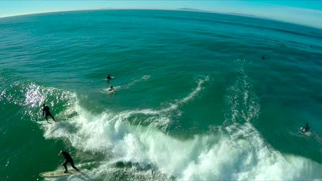 Aerial-over-surfers-riding-waves-on-a-Southern-California-beach-4