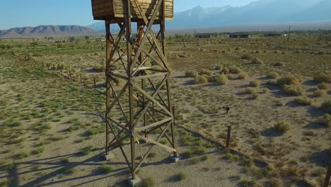 Stunning-rising-aerial-over-the-Manzanar-Japanese-relocation-camp-ruins-in-the-Mojave-Desert-of-California