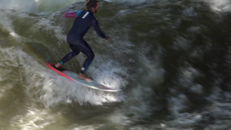 Surfers-brave-the-rapids-of-the-Eisbach-River-in-Munich-Germany-in-slow-motion-1