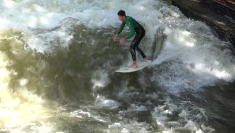 Surfers-brave-the-rapids-of-the-Eisbach-River-in-Munich-Germany-in-slow-motion-3