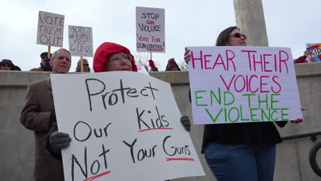Protestors-hold-signs-against-gun-violence-in-schools-during-the-March-For-Our-Lives-Protest-1