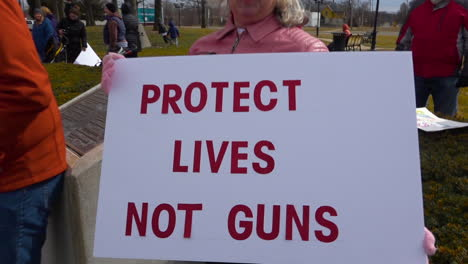 Protestors-hold-signs-against-gun-violence-in-schools-during-the-March-For-Our-Lives-Protest-2