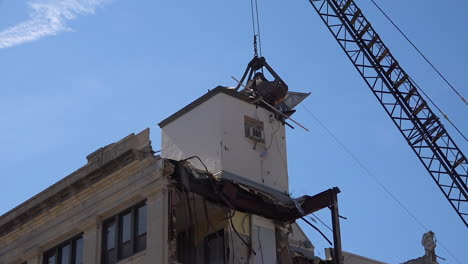 A-claw-demolishes-a-building-during-a-demolition-operation-in-Joliet-Illinois