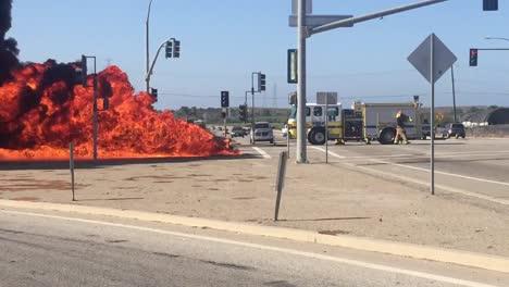 A-car-Kia-Soul-fire-burns-in-an-intersection-with-a-fire-truck-nearby-near-Ventura-California