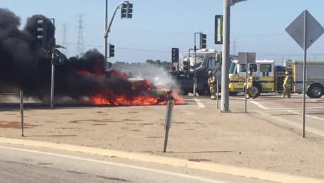 A-car-Kia-Soul-fire-burns-in-an-intersection-with-a-fire-truck-nearby-near-Ventura-California-2