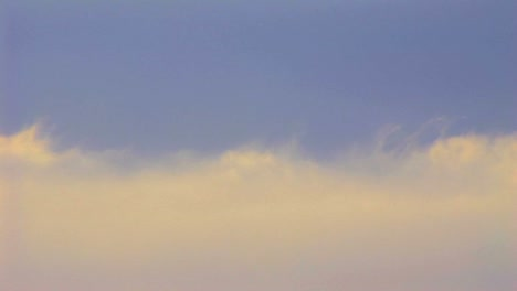 Time-lapse-shot-of-clouds-moving-beneath-a-blue-sky