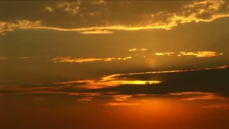 A-golden-sun-peeks-through-a-bank-of-clouds