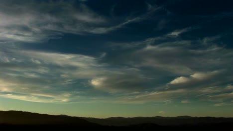 Thin-wispy-clouds-drift-across-a-blue-green-sky