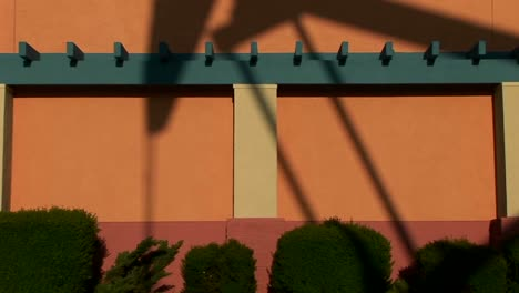 A-giant-oil-rig-casts-a-shadow-against-the-side-of-a-painted-building